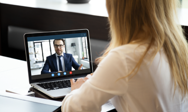 employee talking with their manager on a video call