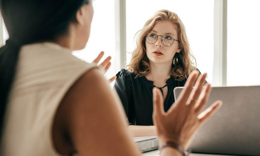 A supervisor explains the new requirements on anti-harassment to an employee.