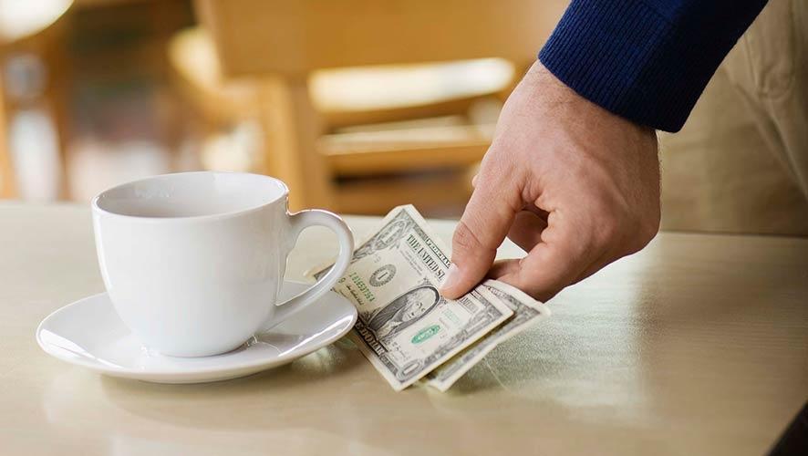 Individual leaving tip at restaurant