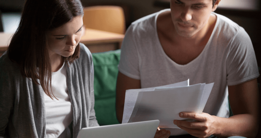 Two People Reviewing a Paycheck