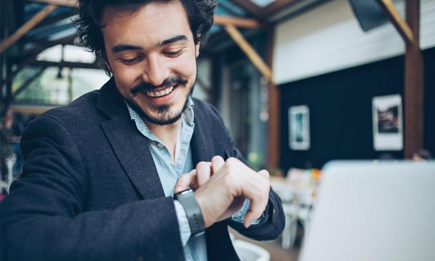 Man using smart watch for time tracking and payroll integration