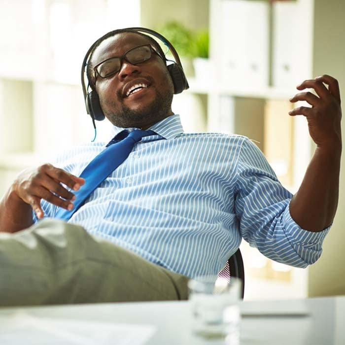 Pros and cons of employees listening to music at work.
