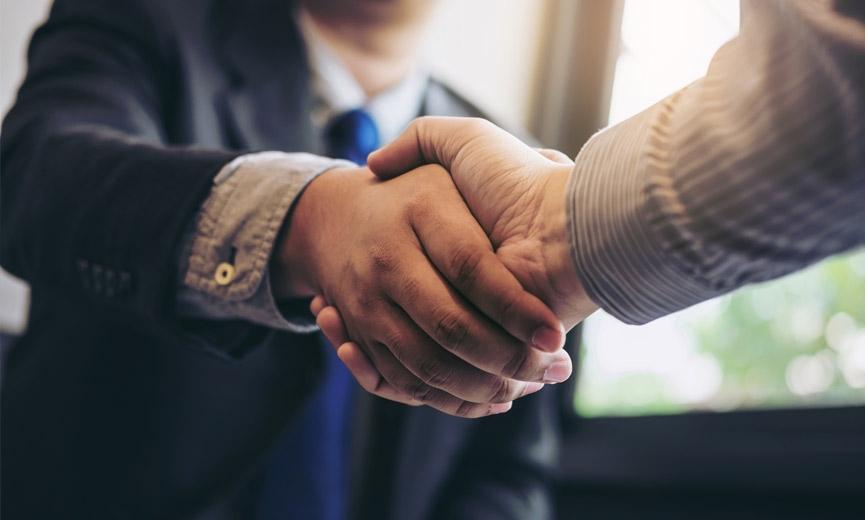 Shaking hands before negotiating workplace benefits