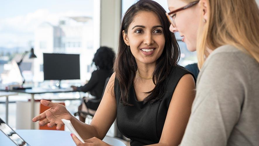 Two women discuss new regulations regarding final rule for regular rate.