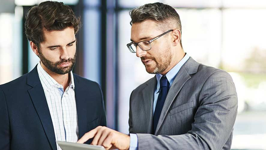 Two accountants go over their firm's cybersecurity policy.