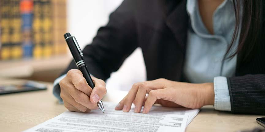 A woman fills out a Form W-4 before starting employment.