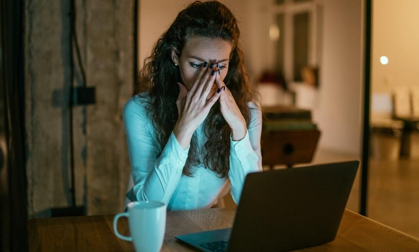 Stressed woman working from home at night
