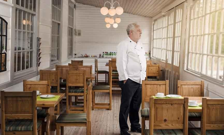 Restaurant owner looking sad because his employees refuse to come back