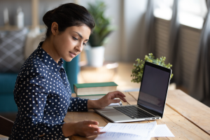 employer on computer working to attract and retain remote employees