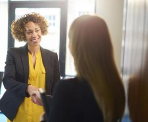 Two woman discussing Hiring Strategies for Small and Mid-Sized Employers