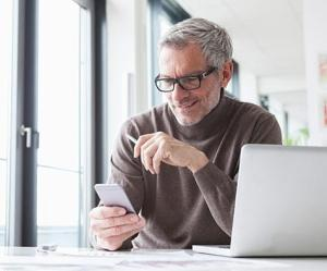man on phone reading about getting back to business