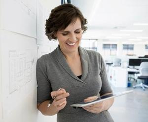 Woman reviewing how to advance the Strategic Role of HR