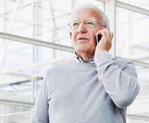 man on phone discussing secure and cares act impact on retirement