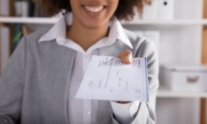 Women depositing FICA taxes