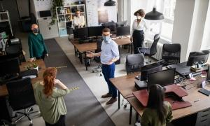 employees social distancing in an office