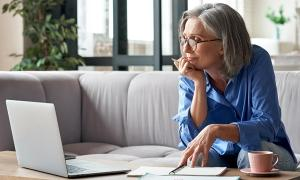 A women considers her options while enrolling with her employer-sponsored retirement program