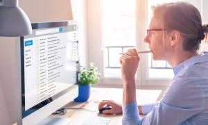 woman looking at email marketing