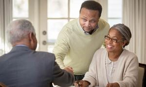 A couple gets information that will help them make a decision about a retirement plan .